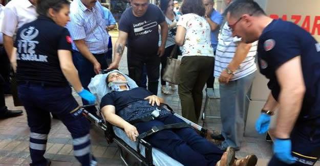 Kaldırımda üzerine tabela düşen kadın yaralandı