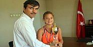 Bir şampiyon da tenisten